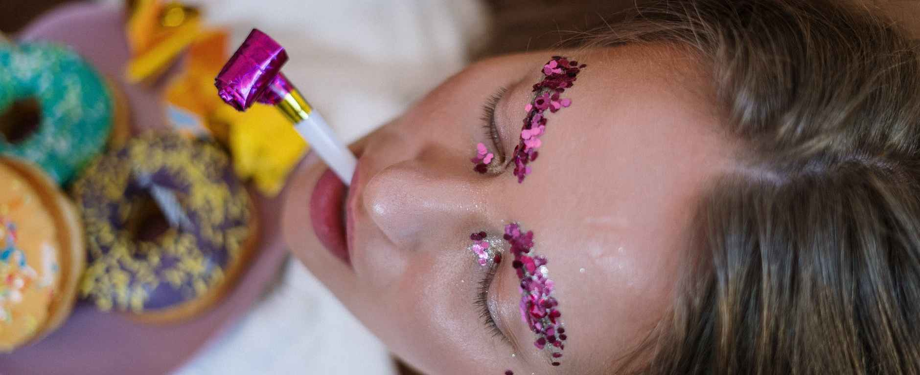 woman with sequins on her eyebrows
