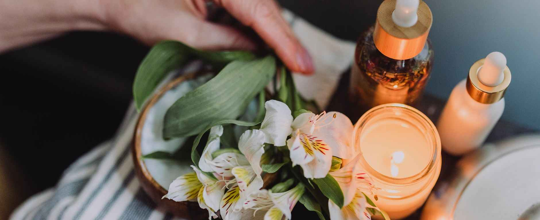 Spa image of candle and flowers with products