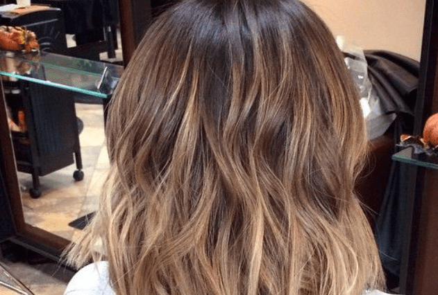 balayage hair colouring on dark hair from the back