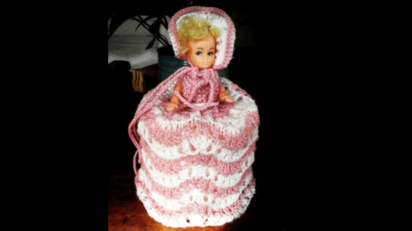 Retro Knitted doll toilet roll cover
