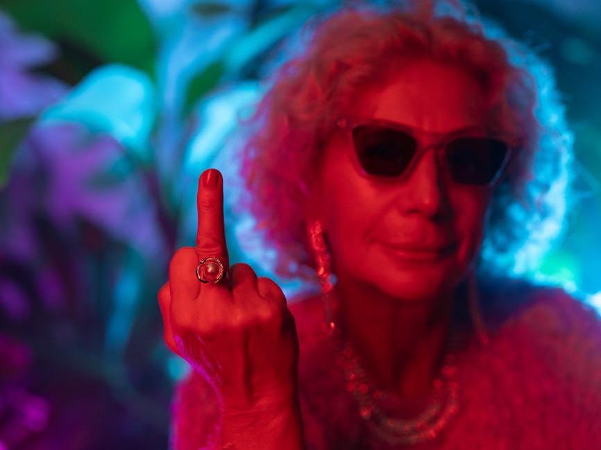 photo of elderly woman wearing sunglasses